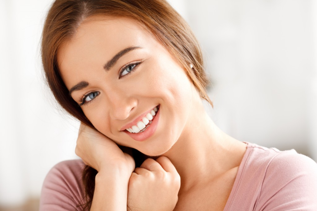 Young woman smiling after having cosmetic dentistry in Brisbane Northside dental clinic