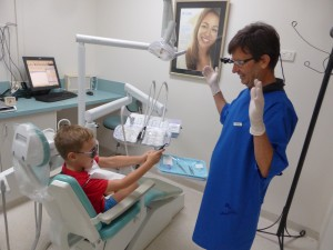 Squirting the dentist with the water pistol. Dental clinic brisbane.